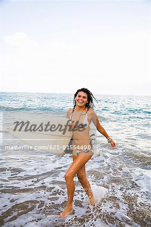 Teenage girl running through surf Stock Photo - Premium Royalty-Free, Image code: 621-01554400