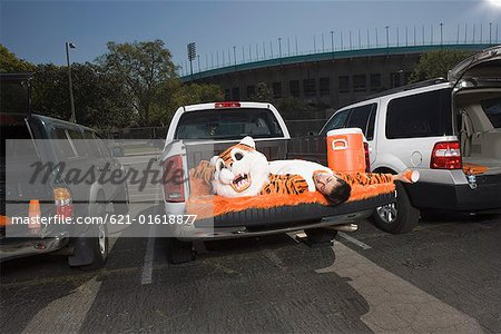 Mascot sleeping on tailgate Stock Photo - Premium Royalty-Free, Image code: 621-01618877