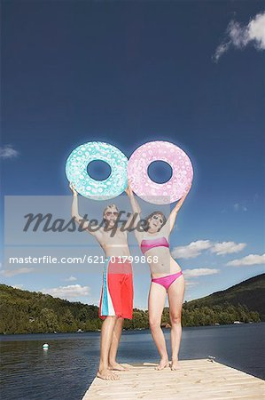 Teen couple with swim rings Stock Photo - Premium Royalty-Free, Image code: 621-01799868