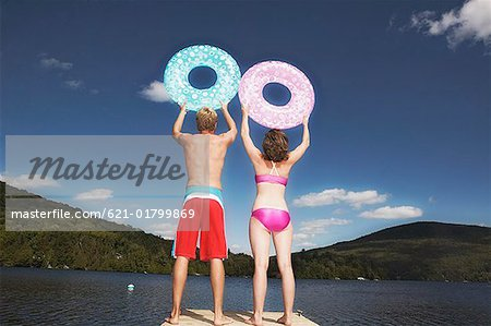 Teen couple with swim rings Stock Photo - Premium Royalty-Free, Image code: 621-01799869