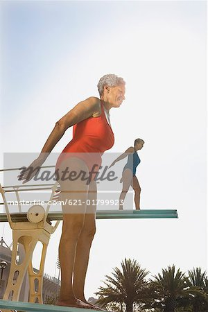 Senior women on diving boards Stock Photo - Premium Royalty-Free, Image code: 621-01799923