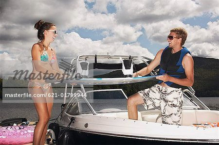 Teenage couple on boat with water ski Stock Photo - Premium Royalty-Free, Image code: 621-01799944