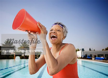 Senior woman swimmer with bullhorn Stock Photo - Premium Royalty-Free, Image code: 621-01799950