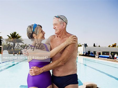 Senior swimmer couple embracing Stock Photo - Premium Royalty-Free, Image code: 621-01800047