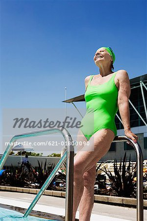 Senior woman swimmer leaning on pool railings Stock Photo - Premium Royalty-Free, Image code: 621-01800090