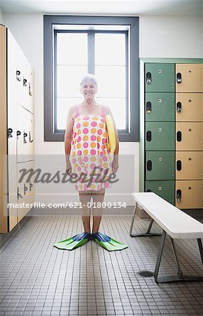 Senior woman swimmer wearing towel and flippers Stock Photo - Premium Royalty-Free, Image code: 621-01800134