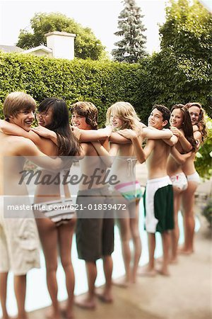 Teenagers standing at poolside Stock Photo - Premium Royalty-Free, Image code: 621-01839472