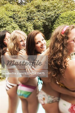 Teenage girls in swimsuits embracing Stock Photo - Premium Royalty-Free, Image code: 621-01839475