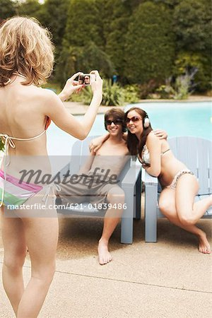 Teenagers posing for picture Stock Photo - Premium Royalty-Free, Image code: 621-01839486