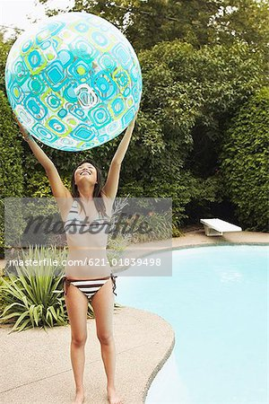 Teenage girl with inflatable ball Stock Photo - Premium Royalty-Free, Image code: 621-01839498