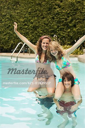 Teenagers playing in pool Stock Photo - Premium Royalty-Free, Image code: 621-01839517