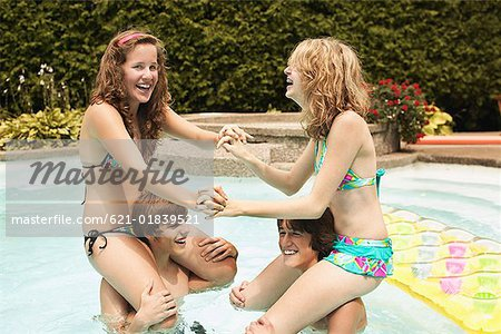 Teenagers playing in pool Stock Photo - Premium Royalty-Free, Image code: 621-01839521
