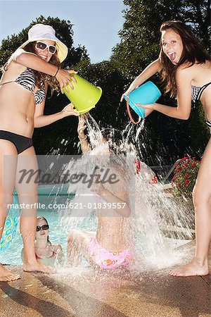 Teenagers pouring water on friend Stock Photo - Premium Royalty-Free, Image code: 621-01839557