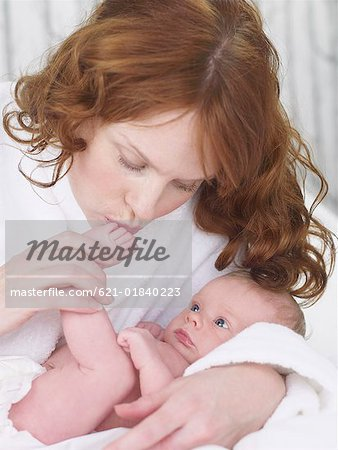 Woman kissing baby's foot Stock Photo - Premium Royalty-Free, Image code: 621-01840223
