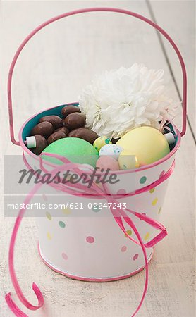Basket of Easter candy Stock Photo - Premium Royalty-Free, Image code: 621-02247243