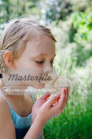 Girl kissing soft chick Stock Photo - Premium Royalty-Free, Image code: 621-02357609