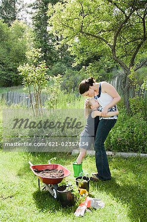Affectionate mother and daughter embracing in garden Stock Photo - Premium Royalty-Free, Image code: 621-02357634