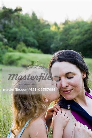 Daughter kissing mother on cheek Stock Photo - Premium Royalty-Free, Image code: 621-02357686