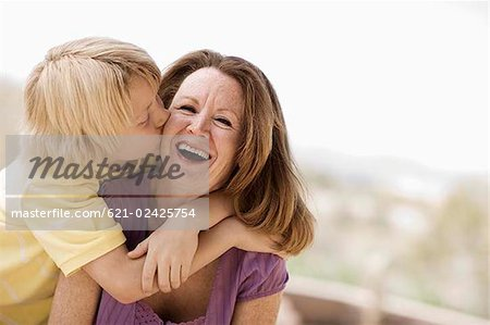 Mother and son embracing Stock Photo - Premium Royalty-Free, Image code: 621-02425754