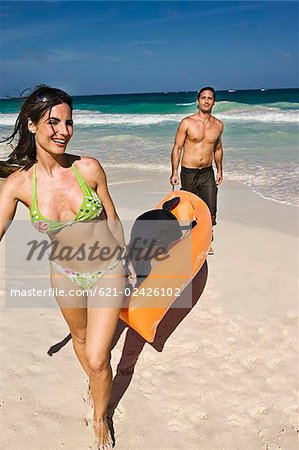 Couple with a canoe at the beach Stock Photo - Premium Royalty-Free, Image code: 621-02426102