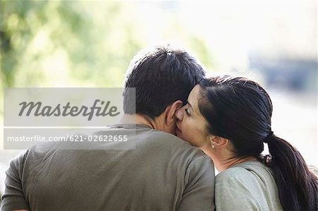 Woman kissing mans neck Stock Photo - Premium Royalty-Free, Image code: 621-02622655