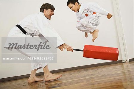 Agility exercise in karate class Stock Photo - Premium Royalty-Free, Image code: 621-02622763