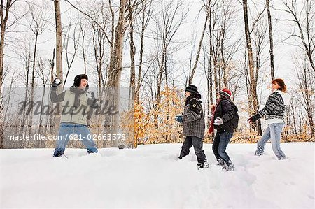 Family having snowball fight Stock Photo - Premium Royalty-Free, Image code: 621-02663378