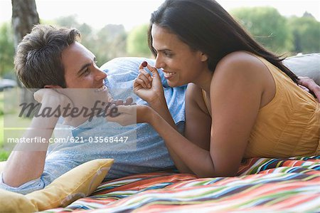 Couple eating grapes on blanket Stock Photo - Premium Royalty-Free, Image code: 621-03568447