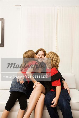 Son and daughter kissing mother Stock Photo - Premium Royalty-Free, Image code: 621-03569233