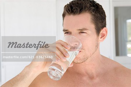 Man drinking water Stock Photo - Premium Royalty-Free, Image code: 621-03623460