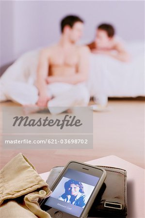 lovers in bedroom blurred, missed call on mobile Stock Photo - Premium Royalty-Free, Image code: 621-03698702