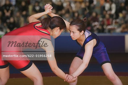 Two Wrestlers Fighting Stock Photo - Premium Royalty-Free, Image code: 622-01956258