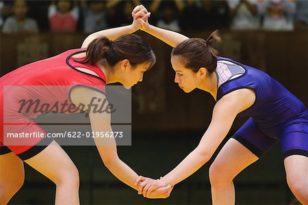 Two Wrestlers Fighting Stock Photo - Premium Royalty-Free, Image code: 622-01956273