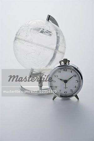 Studio shot of globe with alarm clock Stock Photo - Premium Royalty-Free, Image code: 622-02354370