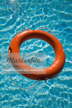 An orange life ring floating in water Stock Photo - Premium Royalty-Free, Image code: 622-02621631