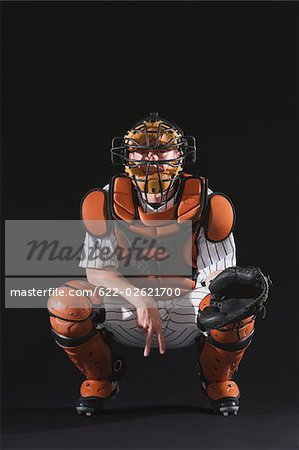 Baseball catcher catching ball Stock Photo - Premium Royalty-Free, Image code: 622-02621700