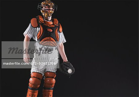 Baseball catcher holding ball in mitt Stock Photo - Premium Royalty-Free, Image code: 622-02621706