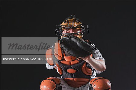 Baseball catcher waiting for ball Stock Photo - Premium Royalty-Free, Image code: 622-02621709