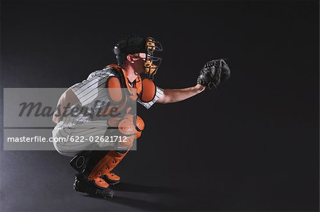 Baseball umpire in crouching position Stock Photo - Premium Royalty-Free, Image code: 622-02621712