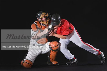 Baseball player sliding into a base Stock Photo - Premium Royalty-Free, Image code: 622-02621724