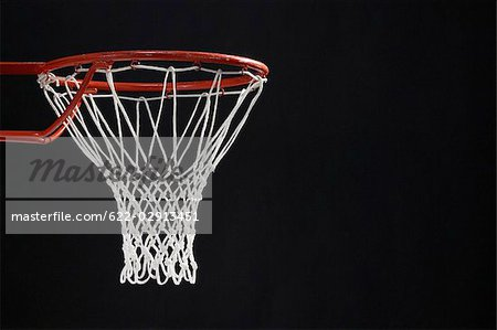 Empty basketball hoop against black background Stock Photo - Premium Royalty-Free, Image code: 622-02913451