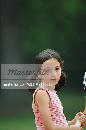 Young Girl Holding Tennis Racket Stock Photo - Premium Royalty-Free, Image code: 622-05390892