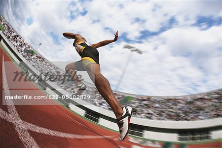 Runner On Race Track Leaving Starting Point Stock Photo - Premium Royalty-Free, Image code: 622-05602829