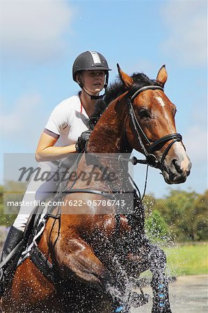 Horse Rider Crossing Water, Equestrian Event Stock Photo - Premium Royalty-Free, Image code: 622-05786743