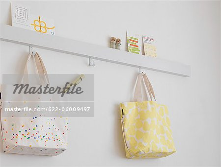 Bags Hanging In Room Stock Photo - Premium Royalty-Free, Image code: 622-06009497