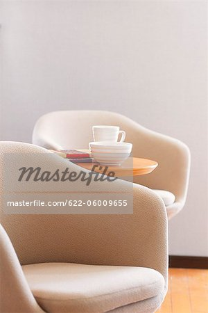 Easy Chair With Side Table Stock Photo - Premium Royalty-Free, Image code: 622-06009655