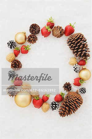 Fruits, Dry Fruits And Baubles With White Background Stock Photo - Premium Royalty-Free, Image code: 622-06163992