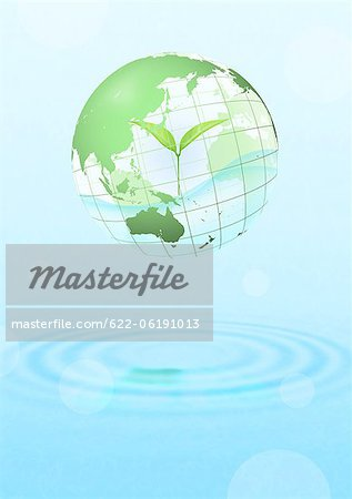 Globe With Leaf Inside Floating Over Water Stock Photo - Premium Royalty-Free, Image code: 622-06191013