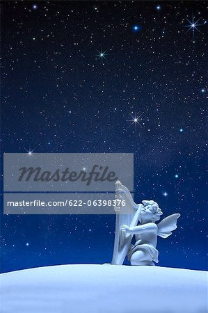 Angel statue and stars Stock Photo - Premium Royalty-Free, Image code: 622-06398376