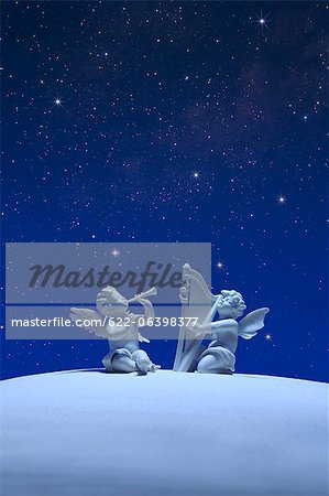 Two angels and stars Stock Photo - Premium Royalty-Free, Image code: 622-06398377